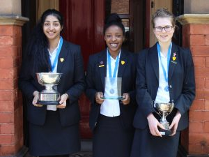 Aditi Nathania and Olivia holding-their-winning-trophies-from-the-regional-heats-and-Nathania-with-her-award-for-Best-Speaker.
