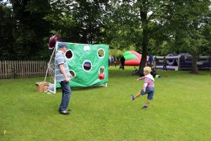 Child playing football at the PTA Summer Fete 2014