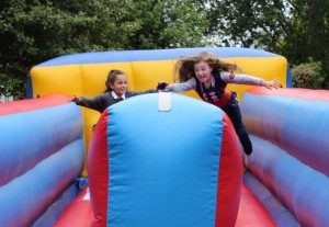 Children playing on the bungee run at the PTA Summer Fete 2014