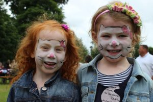 children with their faces painted at the PTA Summer Fete 2014