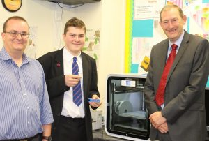 Mr Alex Taylor and Red House pupil try out the latest 3D printer with Engineer (pic left) from Smart Office Solutions Ltd.
