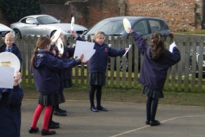 Red House School pupils safely observe the shadow of the moon covering the sun