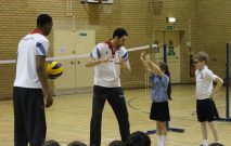 GB Olympian volleyball players Peter Bakare and Nathan French teaching volleyball skills to two pupils