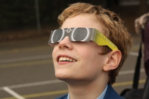 Pupils safely observe the solar eclipse with protective glasses