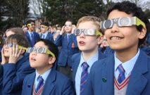 Red House School pupils view the Solar Eclipse through protective glasses