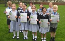 Group of Red House School children hold their LAMDA certificates