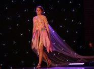 Pupil walking down a catwalk at the Red House School fashion show