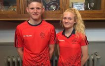 Two pupils wearing the new sample sports kit for Red House School