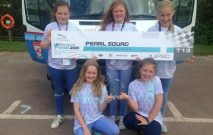 Winners of the Jaguar Primary School Challenge for five pupils from Red House School stand holding their award for Research and Development in the National Jaguar Primary School Challenge.