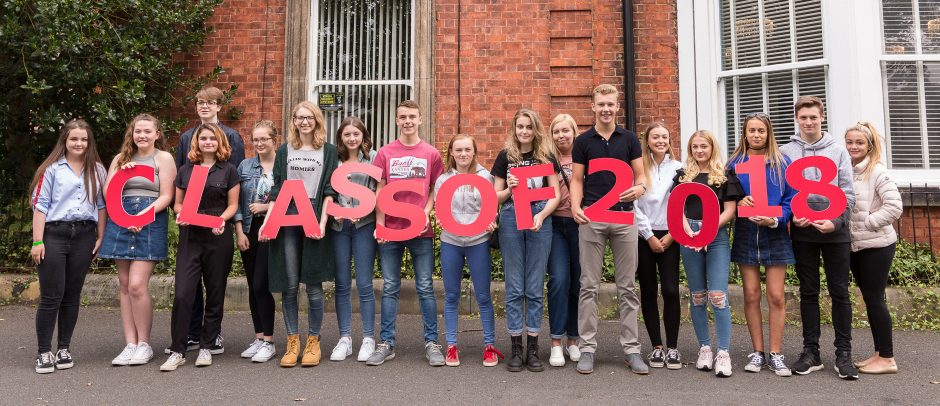 Red House School pupils hold letters saying Class of 2018 whilst celebrating their outstanding GCSE Results
