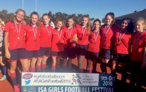 Girls from Red House School celebrate winning the U15 National ISA Football Festival