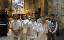 a group of children dressed as angels in their Christmas performance