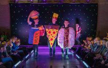 Three Red House School pupils dress up in outfits designed as fast food for the Fashion Show