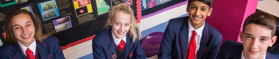 Four Red House School pupils sat working in the Senior School art room