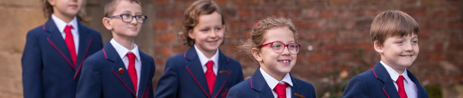 Five Red House School pupils walking outside from St Mary's Church in Norton