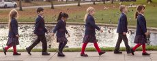 Six Red House School pupils walking alongside the duck pond in Norton village
