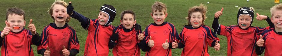Eight Red House School pupils standing together to play rugby