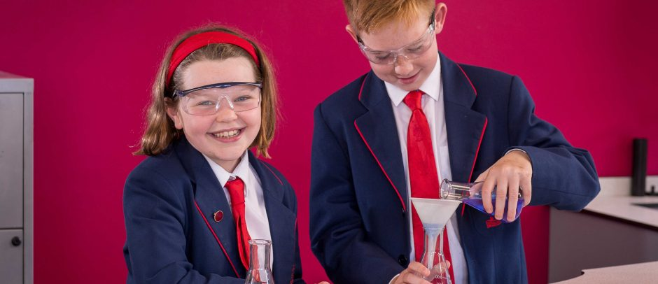 Two Red House School pupils in the science lab measuring liquids