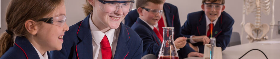 Two Red House pupils are conducting a science experiment