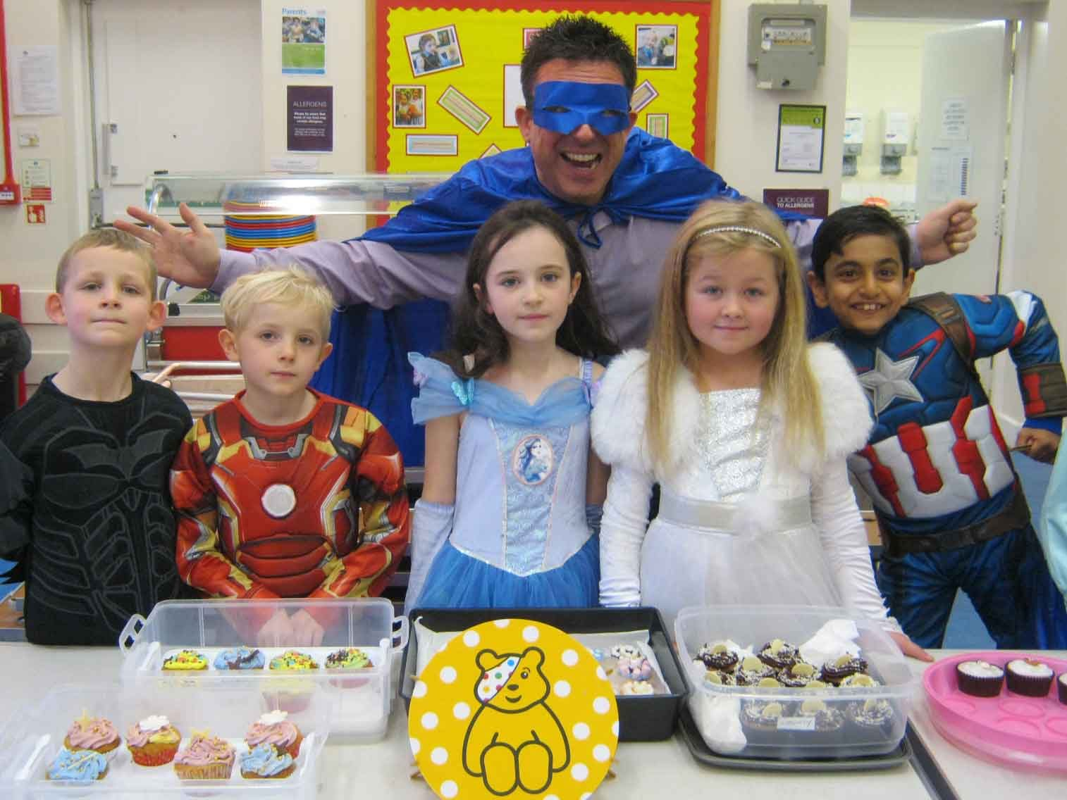 Children and teachers dressed as super heroes for Children in Need