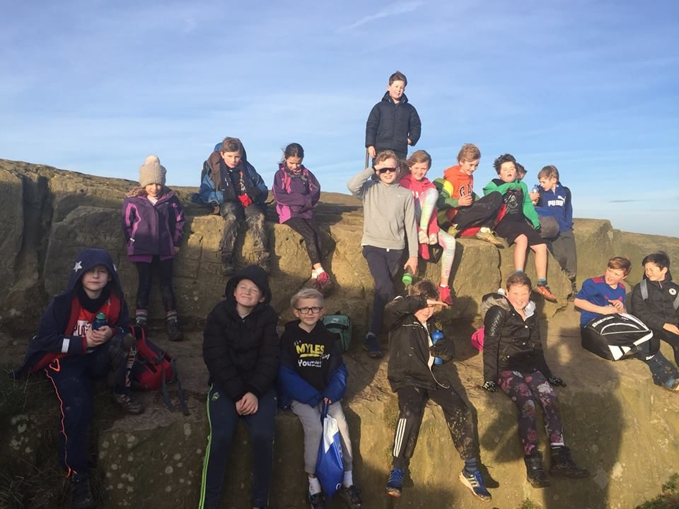 a group of children at the top of roseberry topping