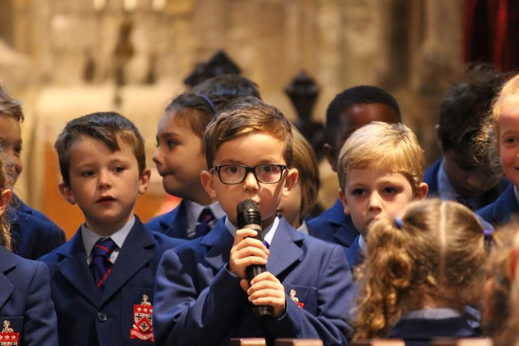 pupils speaking at the Harvest Festival in St Mary's Church