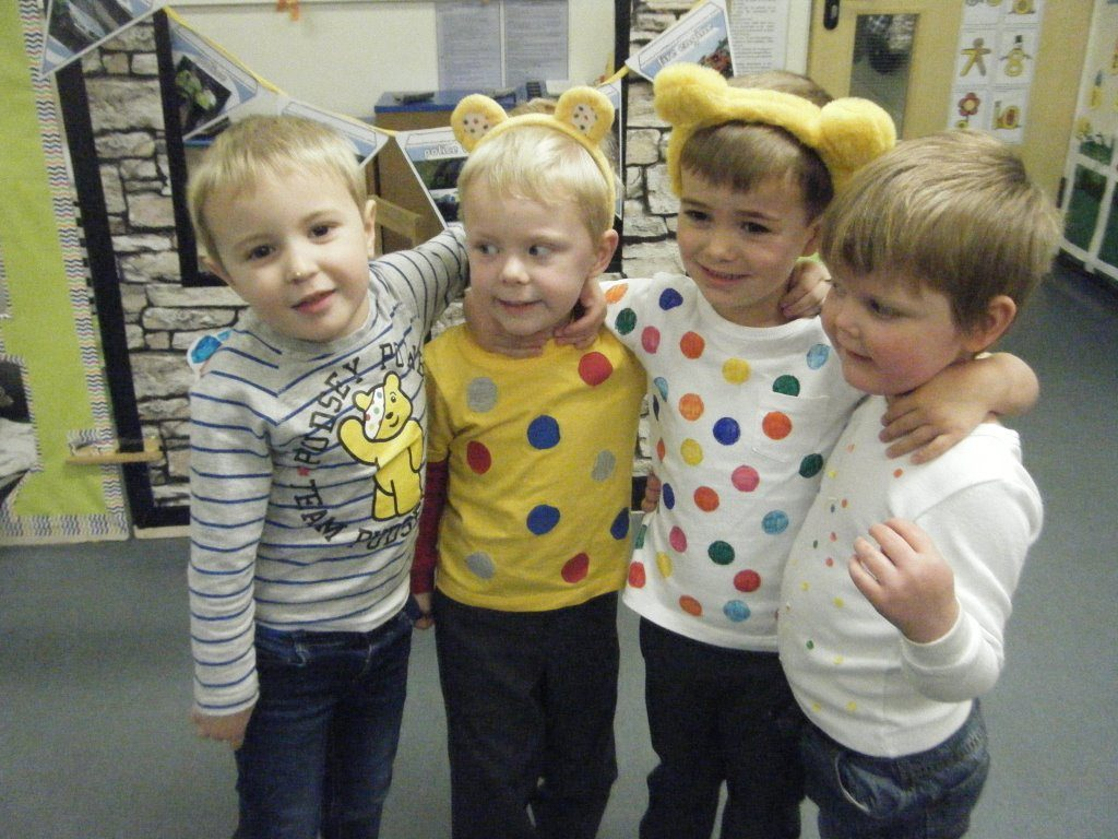 four pupils dressed up for children in need day