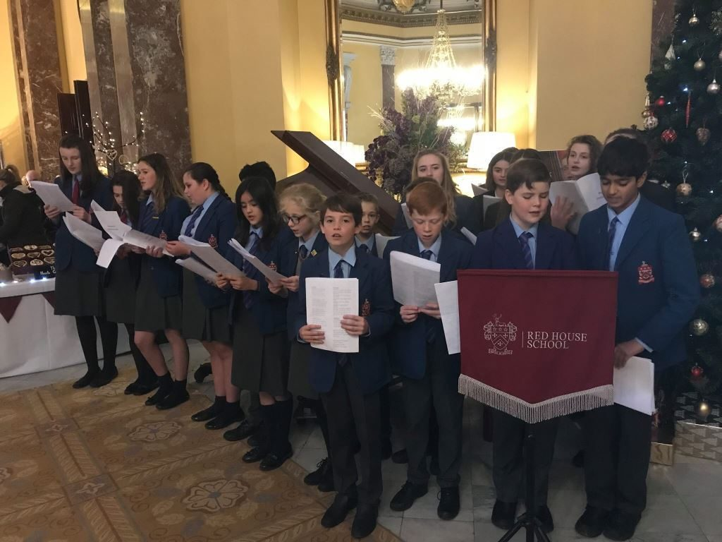 A group of pupils gathered together singing song at Wynyard Hall